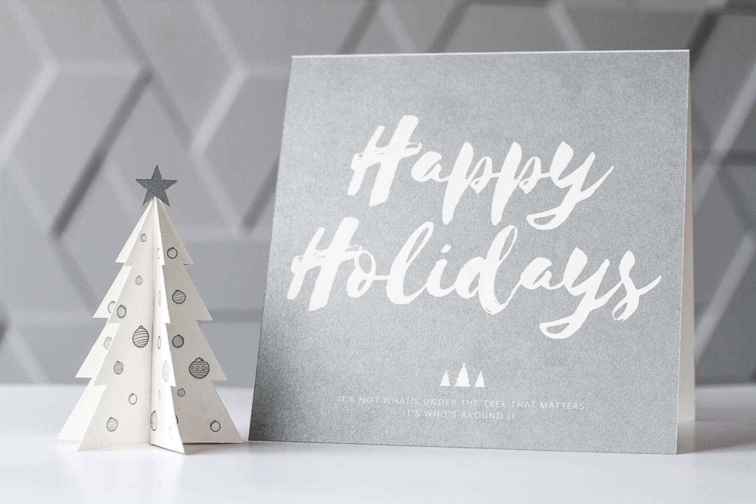 Take your Holiday card to the next level with silver ink and die-cutting.