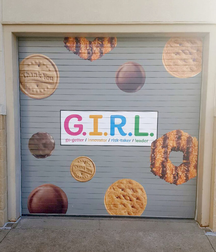 Apply graphics to any surface, even garage doors. Thank you, Girl Scouts!