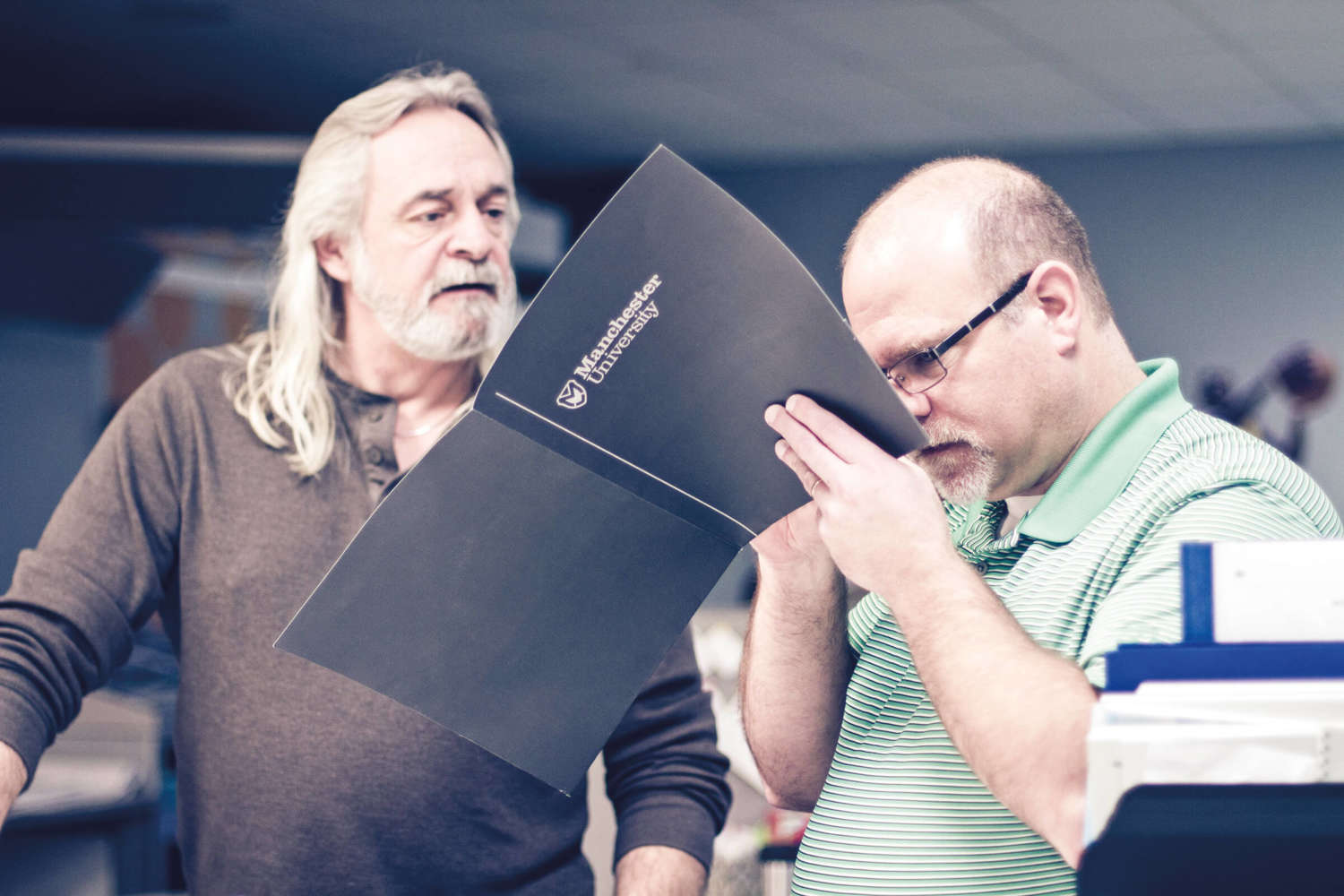 Part-Owner, Jim, and prepress technician, Paul, evaluating a job.